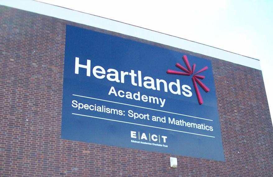 School sign for Heartlands Academy in Birmingham