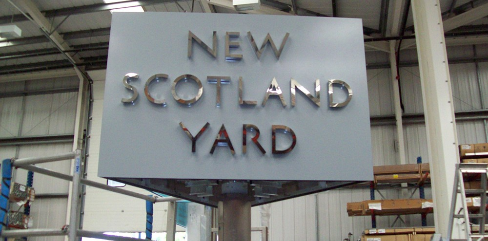 Built up lettering for New Scotland Yard in stainless steel