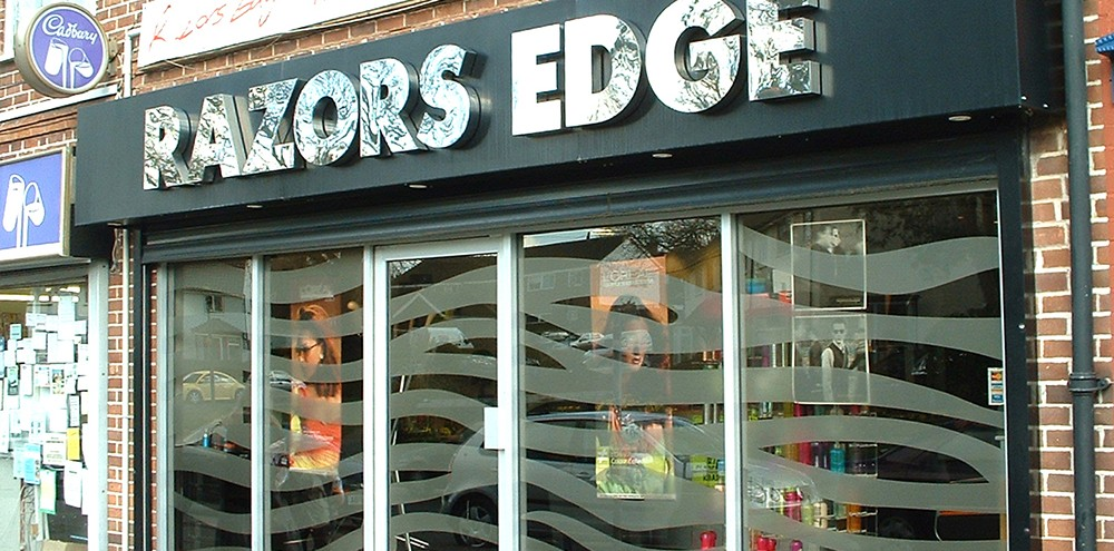 Shop front signage for Razors Edge business in Birmingham